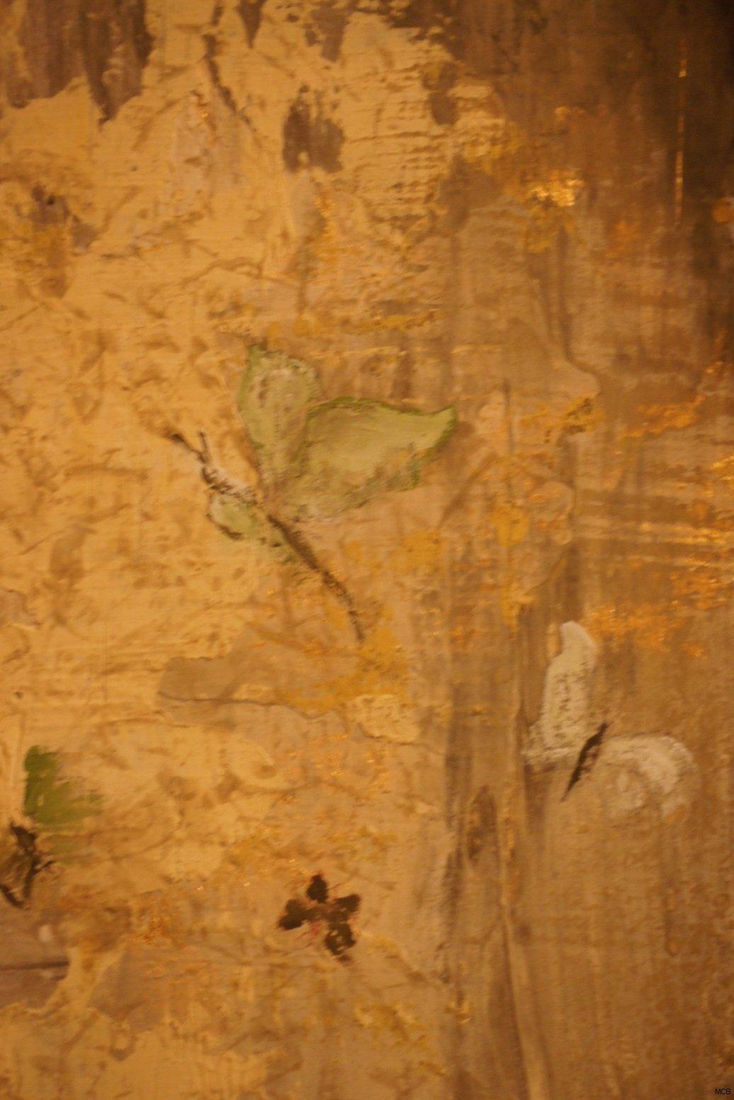 Libellule posée sur un mur
